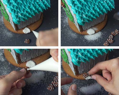 Attaching small royal icing pine cones onto the base cookie with royal icing.