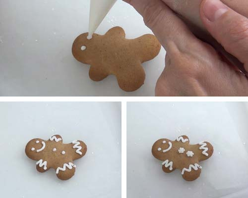 Decorating gingerbread man cookie with white icing.