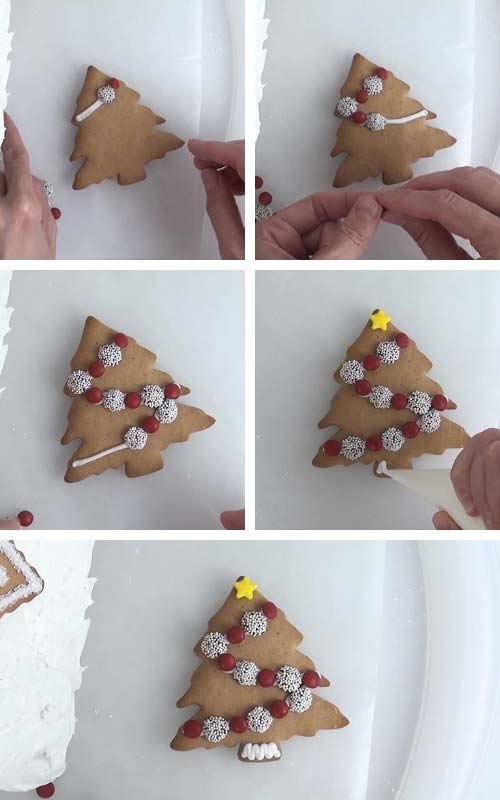 Decorating Christmas tree cookie with chocolate nonpareils and red candies.