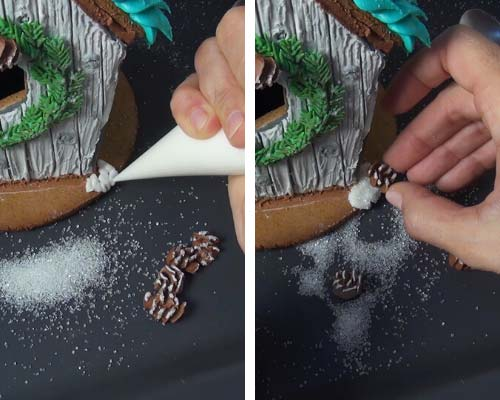 Attaching royal icing pine cone onto a cookie with royal icing.