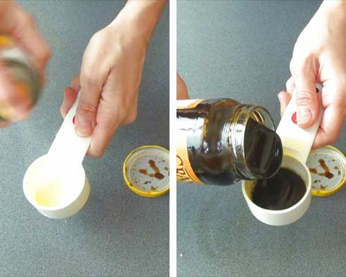 Pouring molasses into a measuring cup sprayed with a nonstick spray.