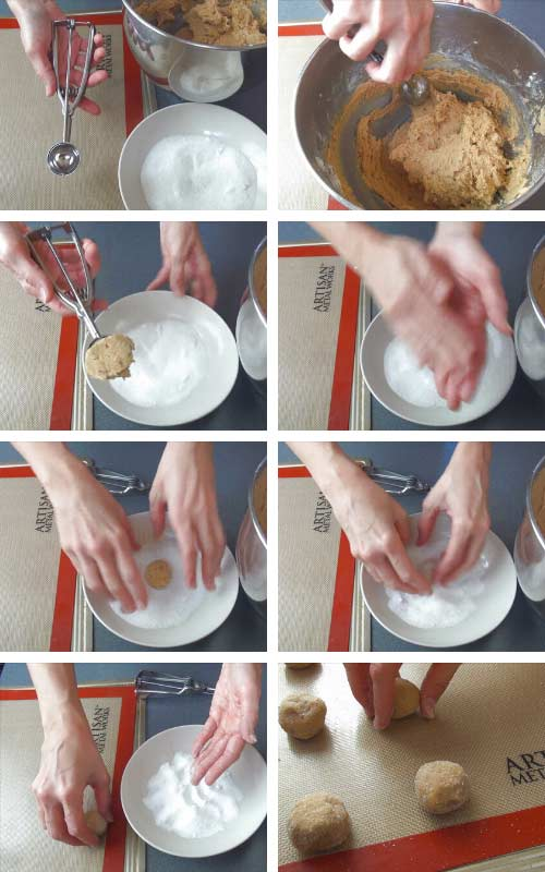 Shaping cookie dough into a ball and rolling the cookie balls in sugar.