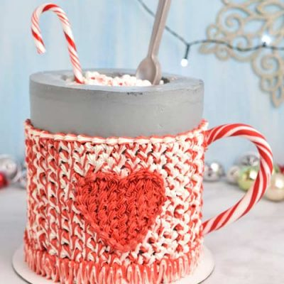 Buttercream mug cake displayed on a marble counter top/