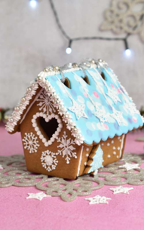 Decorated gingerbread house on a table.