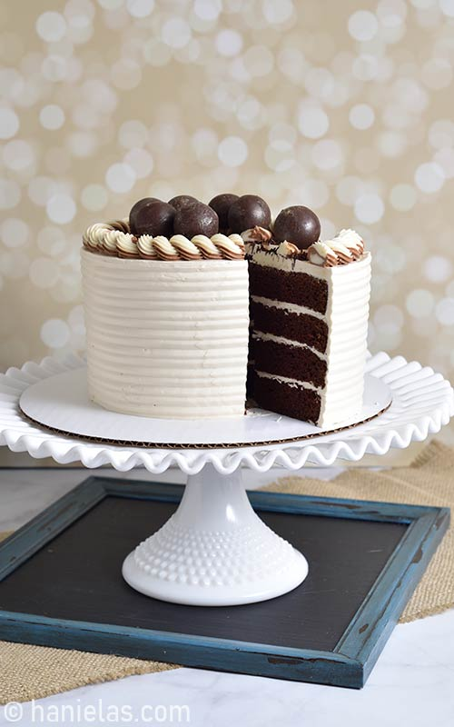 Buttercream cake on a cake stand.