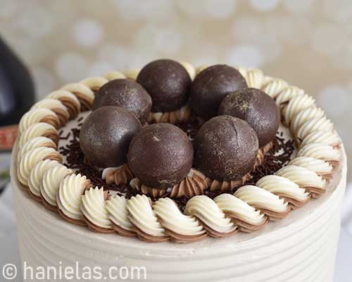 Chocolate spheres on top of the cake.