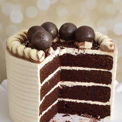 Cut cake showing cake layers.
