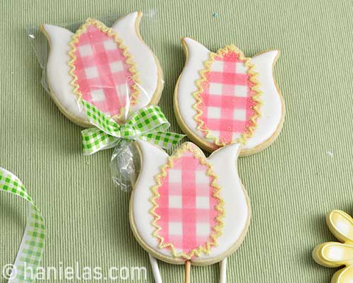 Cookie decorated with royal icing, packaged in a clear poly bag.