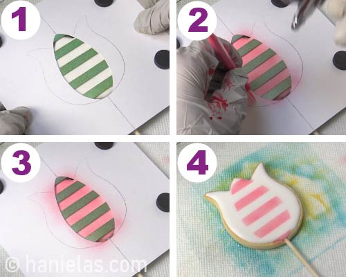 Airbrushing section of a cookie with astripe stencil.