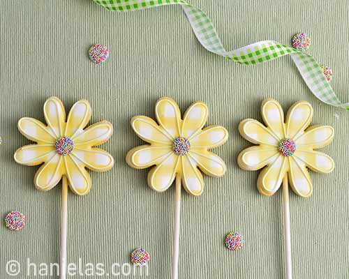 Decorated flower cookies on a table.