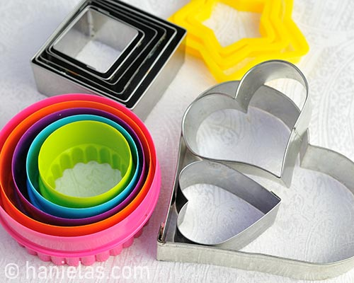 Plastic and metal cookie cutters.