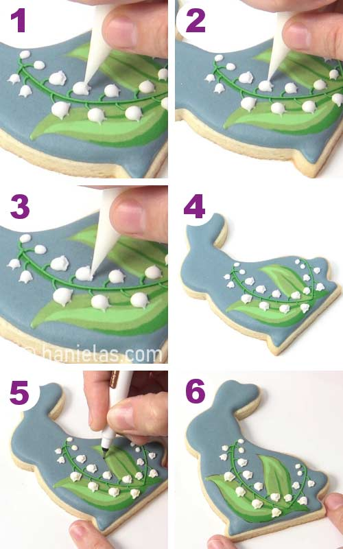 Drawing on royal icing with an edible marker.