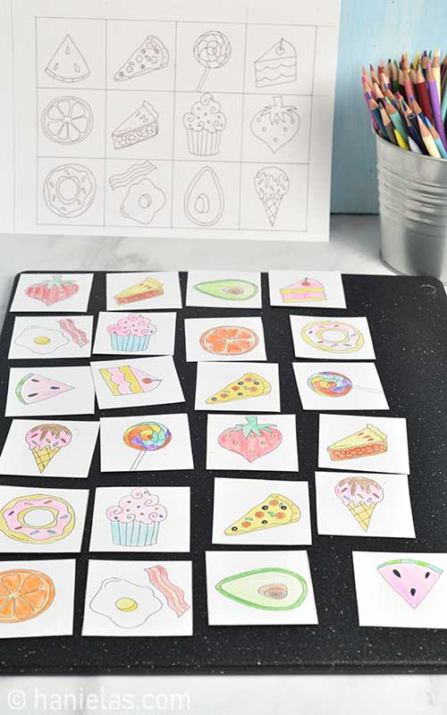 Colored cards places on a flat surface.