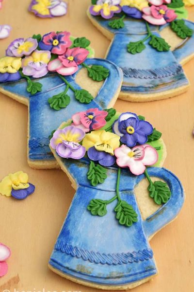 Decorated sugar cookies on a wood board.