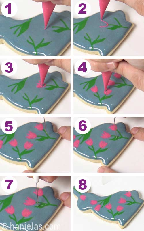 Piping wet on wet flowers with royal icing onto a freshly iced cookie.