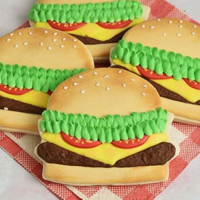Cookies that look like hamburgers decorated with royal icing.