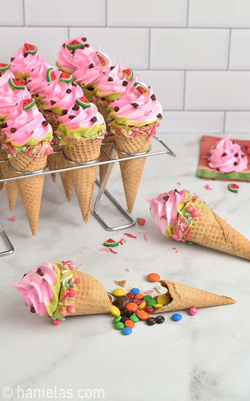 Pinata ice cream cone shaped cookie broken up showing candies inside.