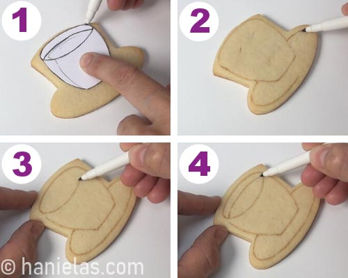 Tracing an outline onto a cookie with edible marker and a paper template.