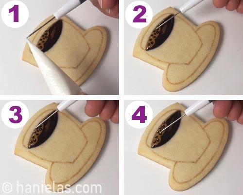 Using a needle tool to add tiny white dots of icing onto an iced cookie.