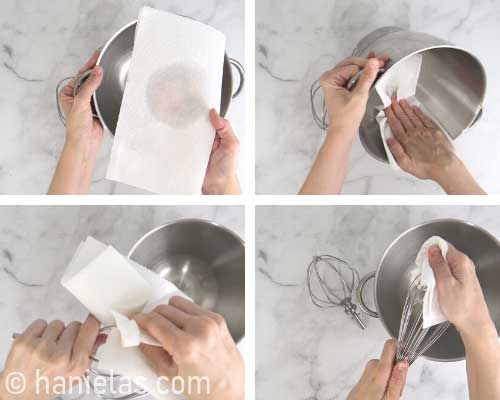 Wiping a stainless steel bowl with vinegar.