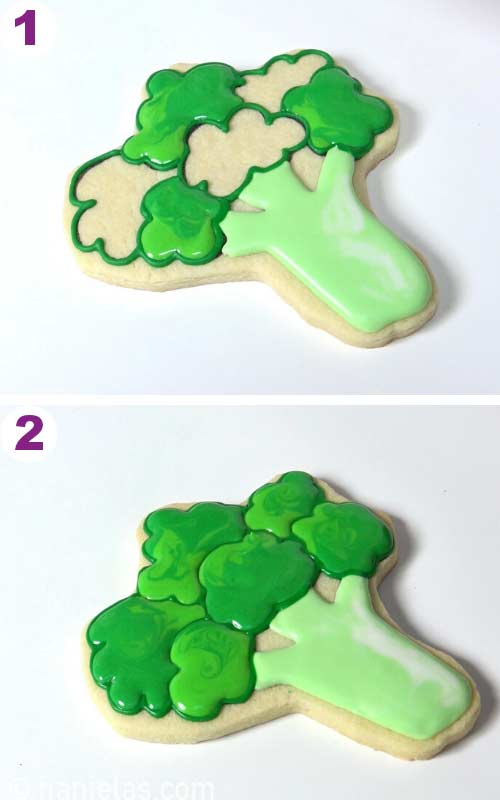 Sugar cookie in a shape of broccoli decorated with royal icing.