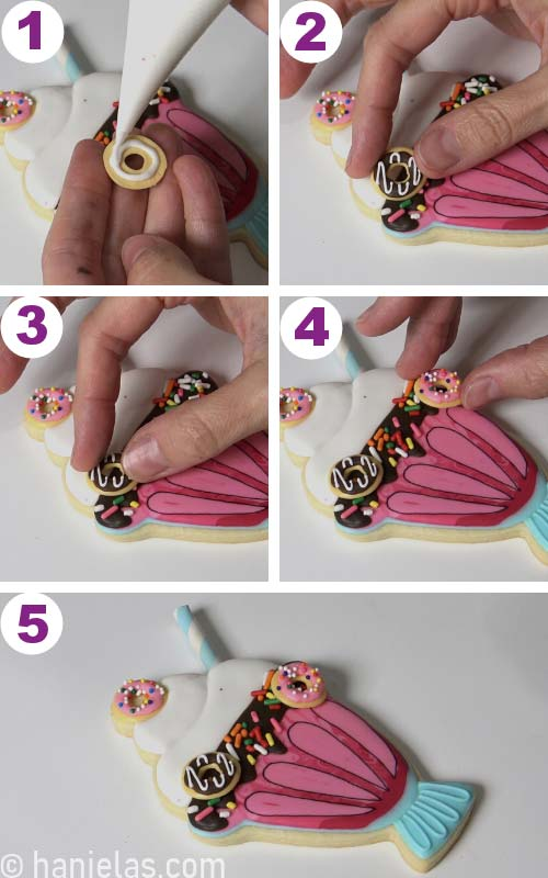 Attaching donut sugar decorations onto a cookie.
