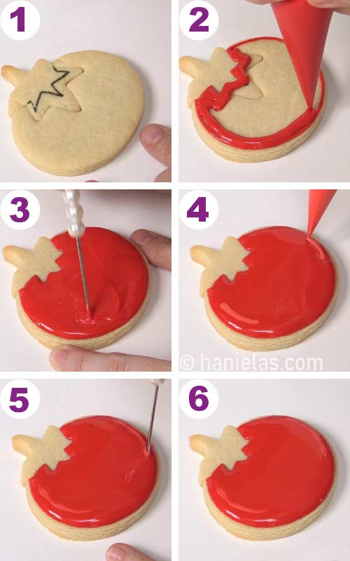 Outlining and flooding a cookie that is shaped like a tomato with red icing.