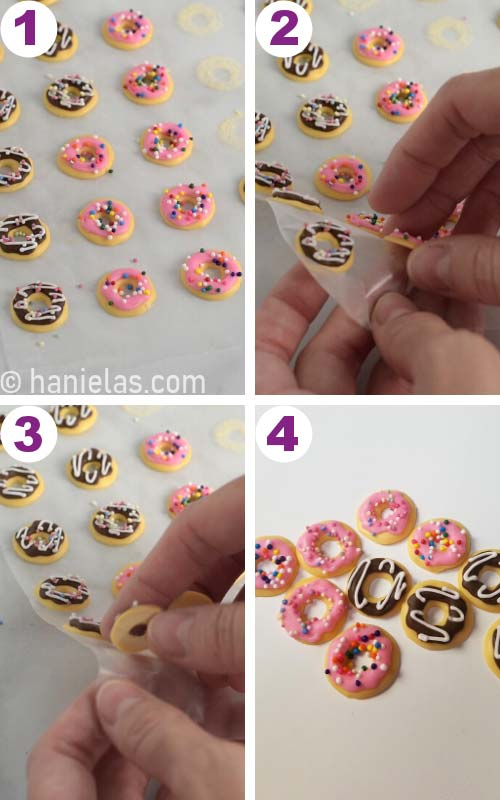 Removing donut decorations from a wax paper.