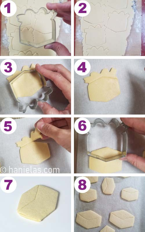 Cutting out cookies with a metal cookie cutter.