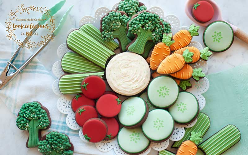 Mini decorated cookies arranged on a platter.