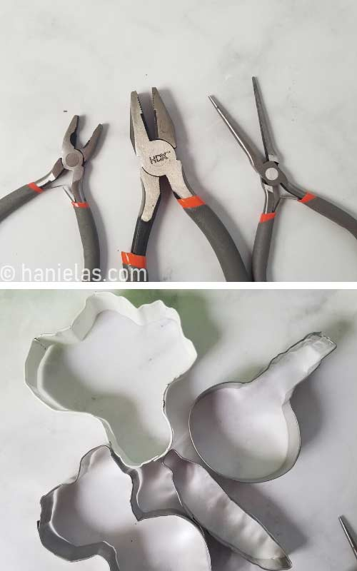 Three types of small pliers on a kitchen counter.