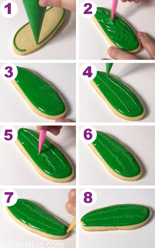 Flooding a cookie with green icing, then piping lighter icing on the top and blending it together.
