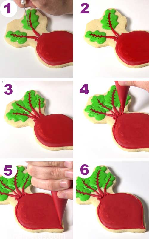 Pulling a tip of a needle tool thru red icing and into green.
