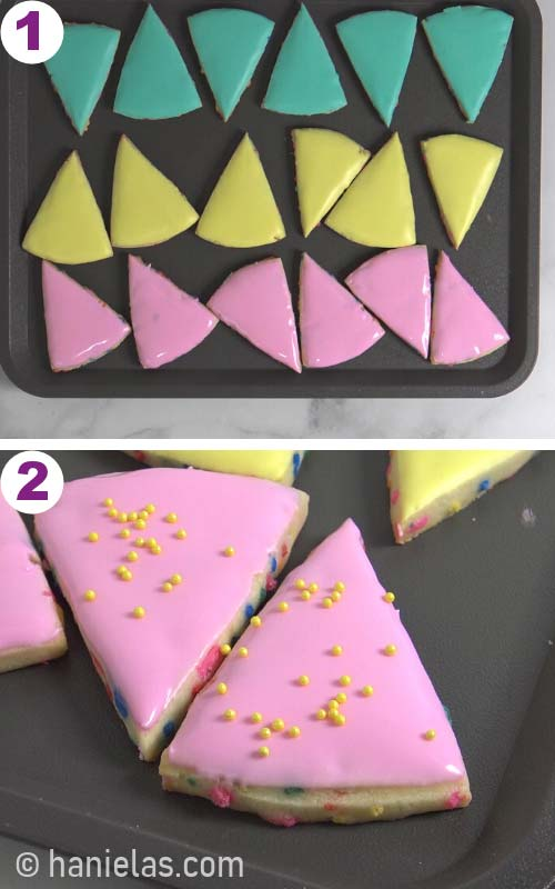 Wedge cookies iced with a teal, yellow and pink icing on a gray tray.