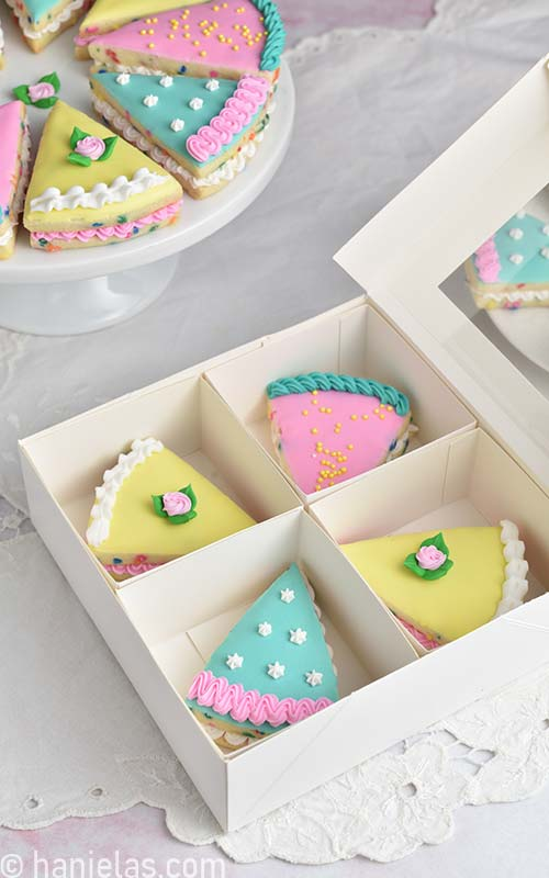 Decorated cookies in a bakery box.