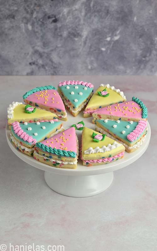 Decorated cookies on a cake stand.