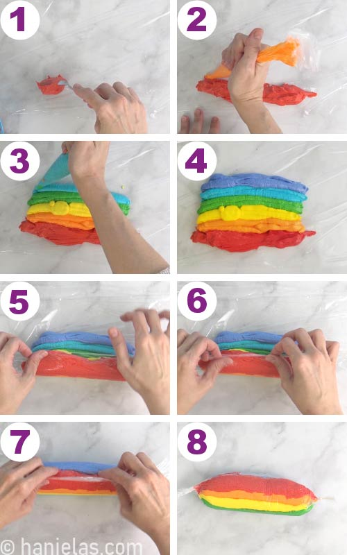 Piping rainbow buttercream stripes onto a food wrap and shaping it into a log.