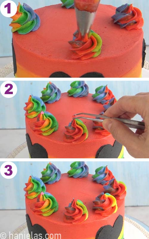 Piping rainbow buttercream swirls on top of the cake and decorating swirls with heart sprinkles.