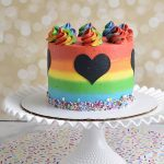 Decorated cake with rainbow buttercream frosting.