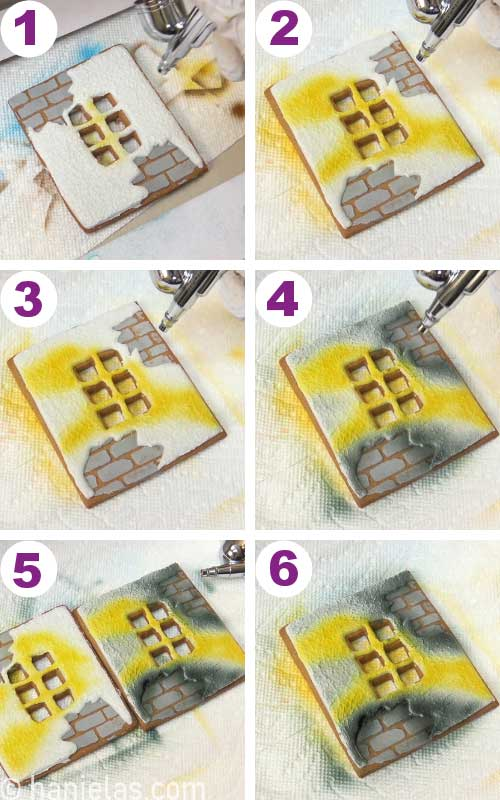 Airbrushing side house panel with small windows with a yellow and black airbrush colors.