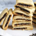 Fig Newton Cookies stacked on a plate.