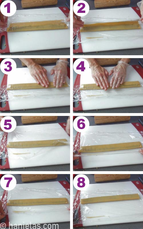 Flattening cookie dough with fingers.