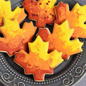 Maple leaves cookies decorated with royal icing.