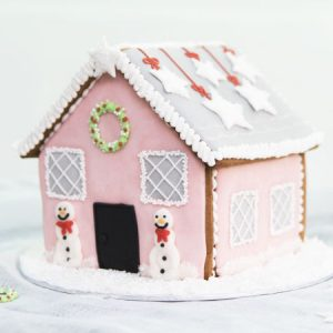 Pink Christmas Decorated Gingerbread House.