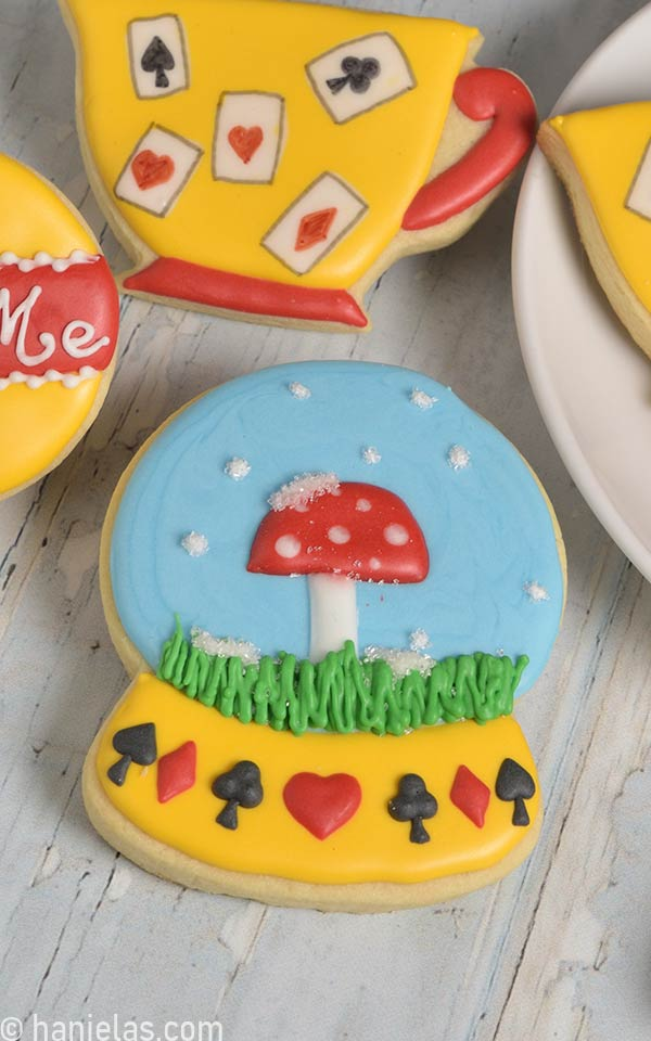 Snow globe cookie decorated with a mushroom design.
