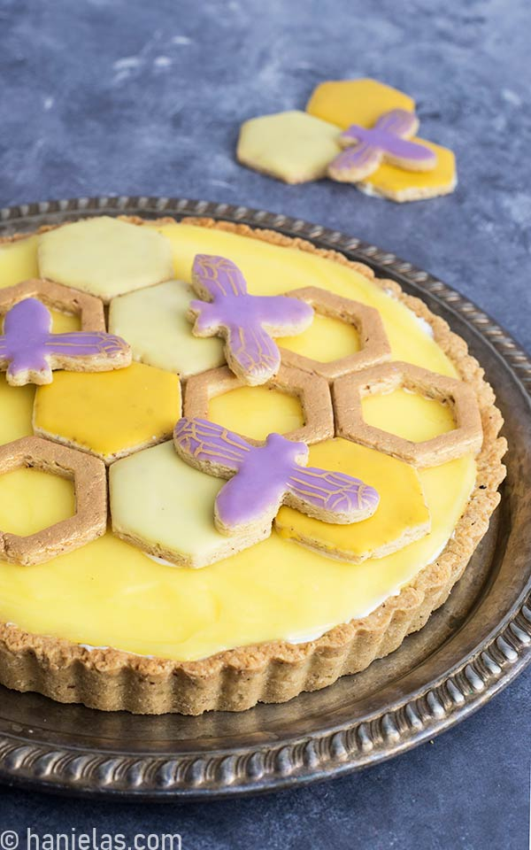 Almond tart crust filled with cream cheese filling and topped with lemon curd topping.