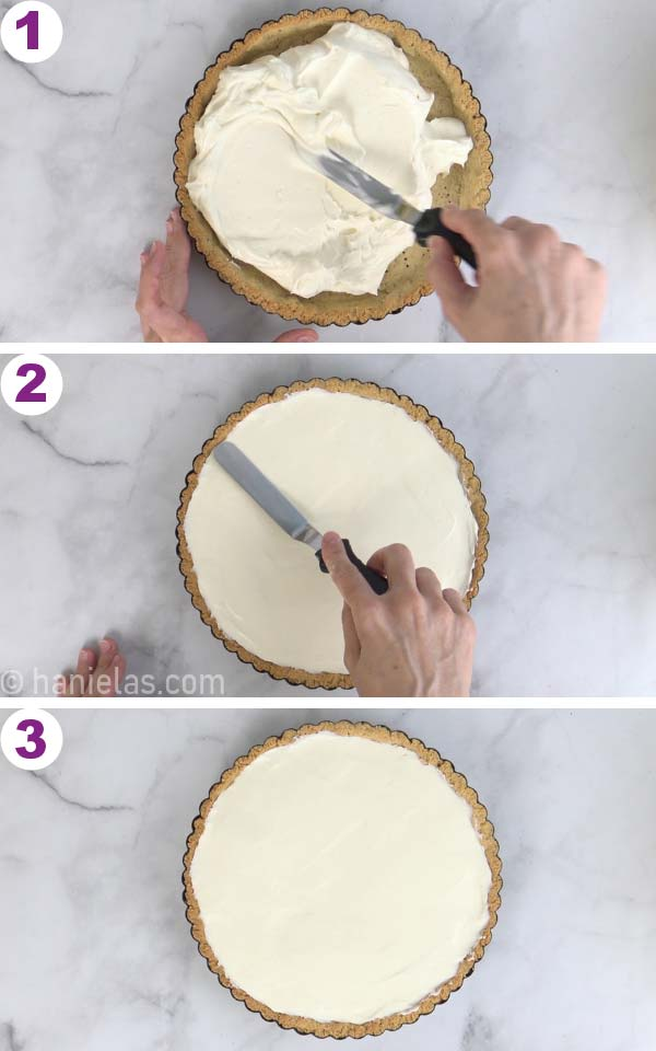Spreading cheesecake filling into an almond tart shell.