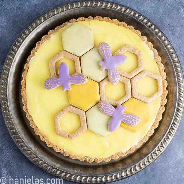 Top view of cheesecake tart with a lemon curd topping.