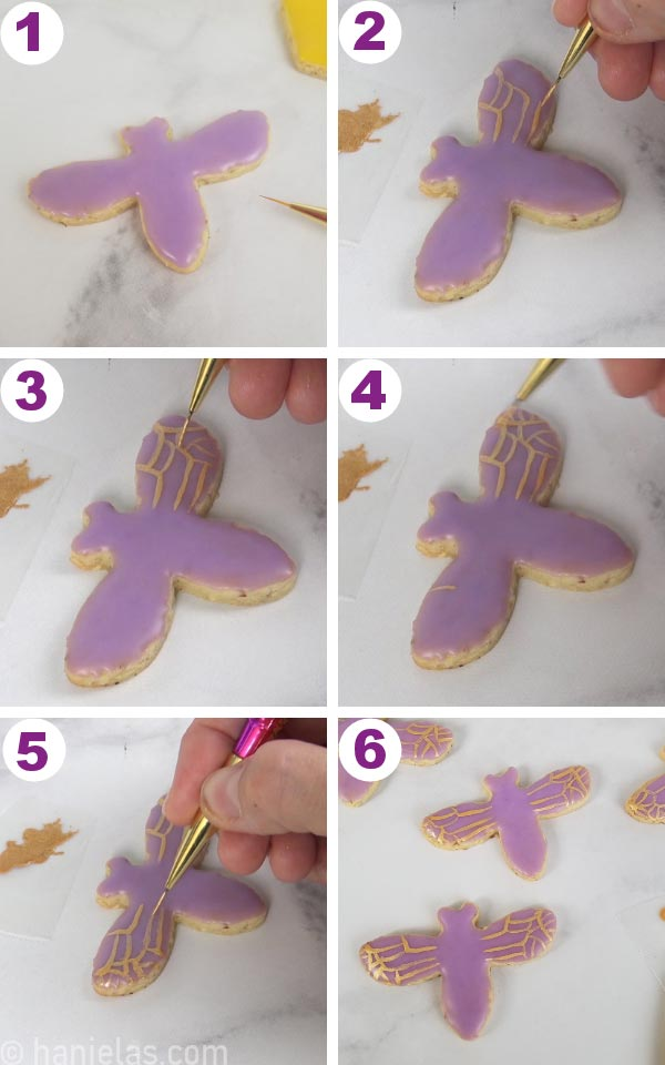 Painting iced bee cookie with an edible gold paint.
