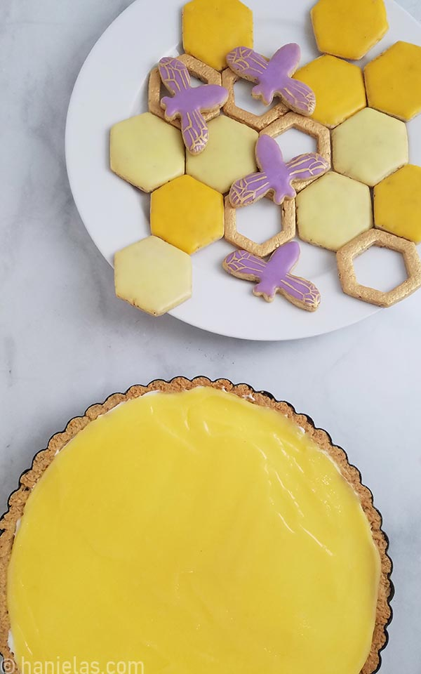 Plate with yellow, gold and purple decorated cookies.